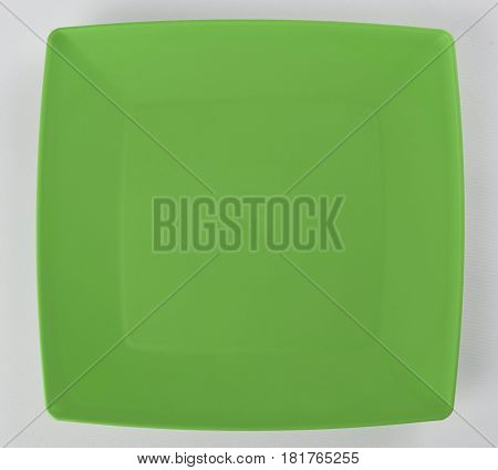 Green plastic shallow dish food top view