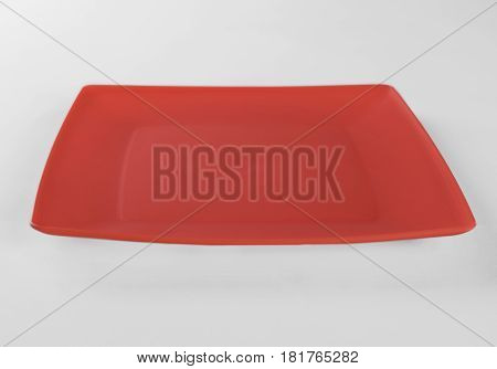 Red plastic shallow dish food isolated on white background