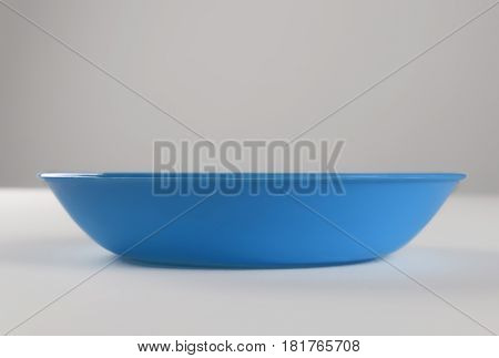 Blue plastic shallow dish food on the table