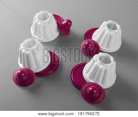 Set of four plastic colorful pudding moulds top view