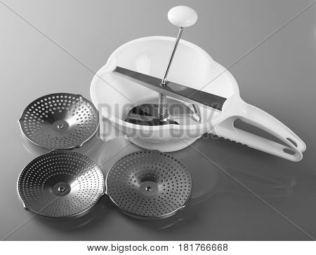 Rotary grater with a crank handle and accessories