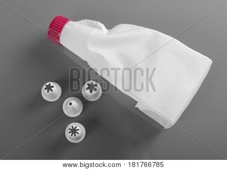 Empty piping bag with different pastry on gray background
