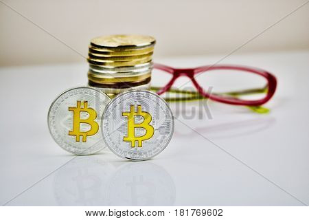 Digital cryptocurrency physical silver bitcoin coins and glasses
