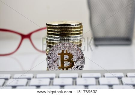 Silver Bitcoin Coin With Yellow B Sign
