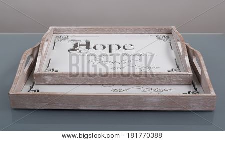 Empty wooden trays with carved text and decoration for serving food or beverages