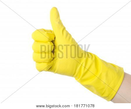 Yellow cleaning glove against isolated on white background