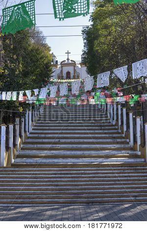 Long concrete stairway leads to Catholic church Iglesia de Guadalupe in the Mexican colonial city of San Cristobal de las Casas in Chiapas