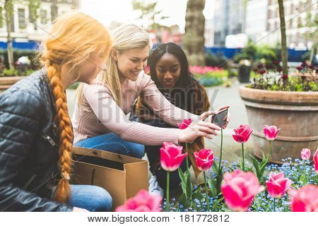 Girls Taking Photos Of Tulip Flowers In London