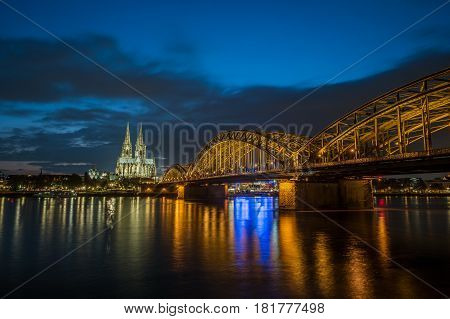Sunset view of Cologne Cathedral and Hohenzollern Bridge, Germany. Travel photo of Germany.