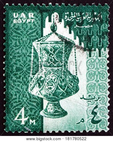 EGYPT - CIRCA 1958: a stamp printed in Egypt shows 14th Century Glass Lamp and Mosque circa 1958
