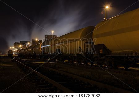 A chemical train in the depot. Gas vapors in the cold night.