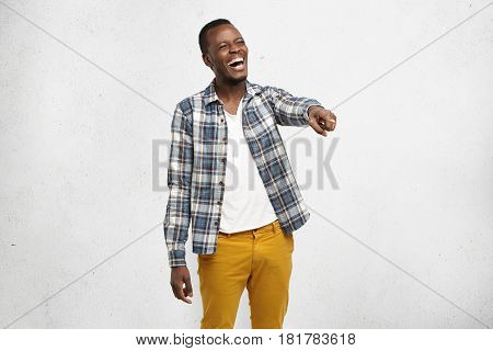 Body Language, Gestures. Portrait Of Charismatic Dark-skinned Student Wearing Checkered Shirt, Laugh