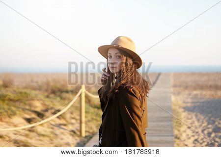 People, Leisure, Lifestyle And Travel. Happy And Carefree Brunette Girl Walking Down The Coastline,