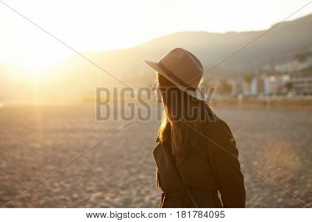 Caucasian Woman Traveling Alone, Visiting European Town, Walking Down Sea Shore In Fall Or Spring. H