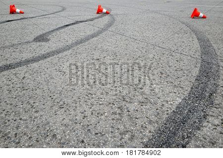 tire marks on the asphalt and posts a warning