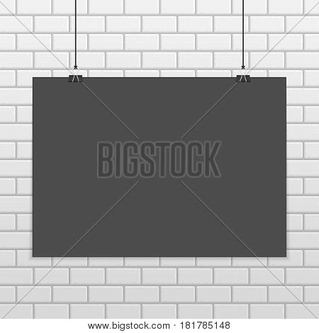 Black horizontal poster mock up on white brick wall. Empty dark A4 sized vector sheet of paper hanging with paper clips. Realistic style. Show your flyers, brochures, headlines etc. EPS10.