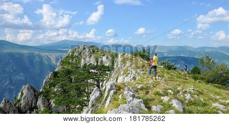 DURMITOR PARK, MONTENEGRO - JULY 30, 2016: tourists on top of Curevac Mount, viewpoint ofcanyon over Tara River