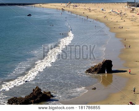 Newport Beach, California, circa January 2017. People enjoying sunny day at the beach - view from vista point above the beach.