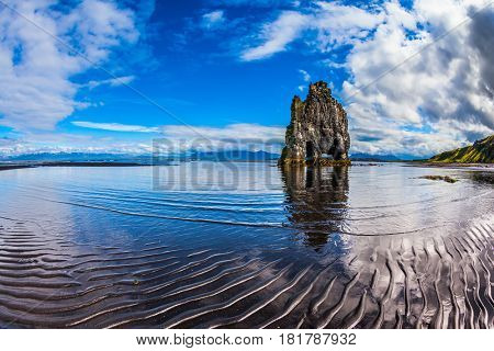 Scala Hvitsercur on the beach in the form of a huge elephant. Northern coast of Iceland. Ocean outflow at sunset. Concept of extreme northern tourism
