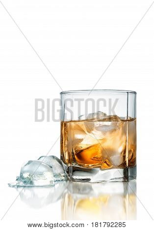 Glass of whiskey with ice isolated on white background