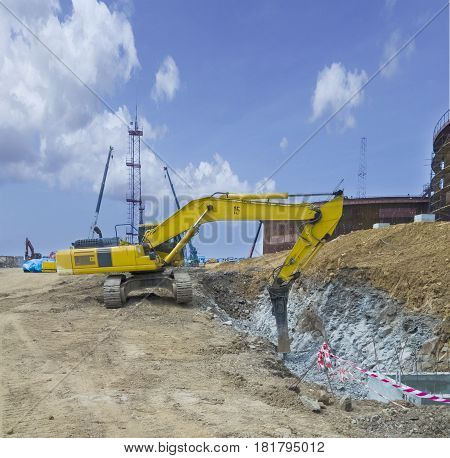 Hydraulic crusher for excavator at the site of rock destruction