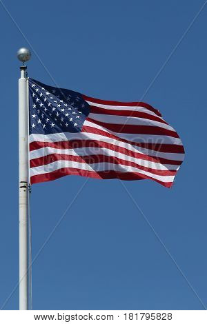 American flag flying high in Brooklyn, New York