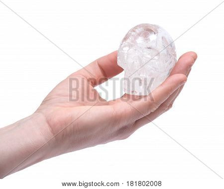 Hand of young woman with clear quartz skull isolated on white background