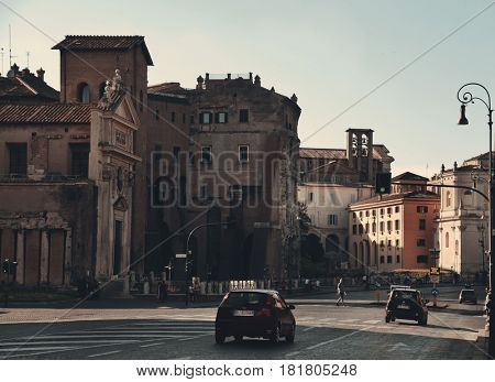 ROME - MAY 12: A typical street view with traffic and old buildings on May 12, 2016 in Rome, Italy. Rome ranked 14th in the world, and 1st the most popular tourism attraction in Italy.