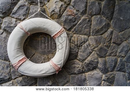 Life Saving Rubber, Lifebuoy Hanging On Rock Wall