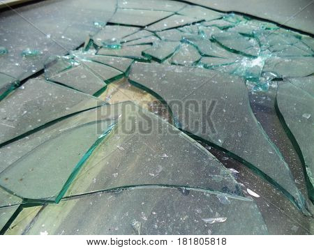 Detail of broken glass on ground for background