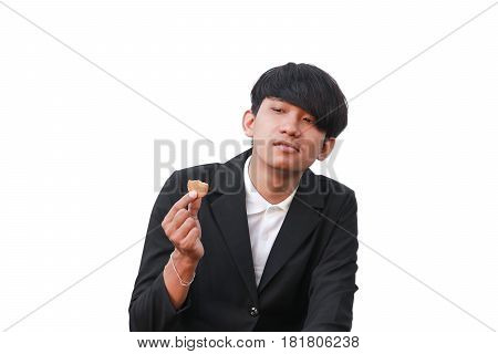 Young man handsome eat cookie small pieces on white background
