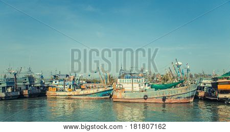 Old wreck Ship Harbor fishing and travel boat stranded. Thailand