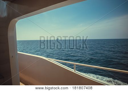 Luxury ship yacht window with a relaxing seascape ocean and blue sky view