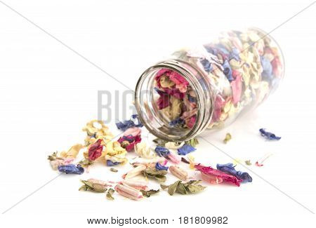 Colourful Potpourri in a jar on a white background with shallow depth of field