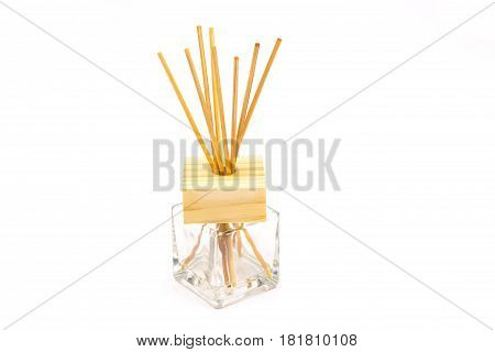 Handmade reed freshener on commode on white background
