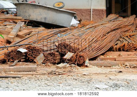 steel bar iron in a construction site is rust on the ground select focus with shallow depth of field.