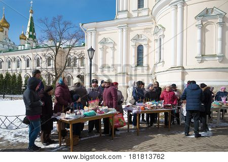 SAINT PETERSBURG, RUSSIA - APRIL 15, 2017: Parishioners in anticipation of the consecration of Easter food in Voskresensky Novodevichy convent