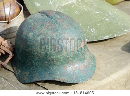 Rusty And Holed Military Helmet