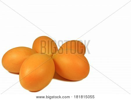 Vibrant Yellow Fresh Ripe Marian Plum fruits in Thailand Isolated on White Background