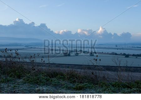 Daybreak looking south down Ouse Valley floodplain towards Newhaven in East Sussex