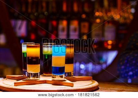 Colorful alcohol  shot drinks on bar. cocktail