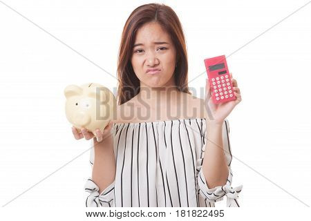 Unhappy Asian Woman With Calculator And Piggy Bank.
