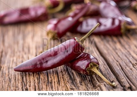 Chili.Red chili peppers on wooden table. Selective focus.