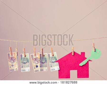 House With Key And Banknotes