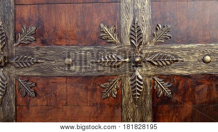 Wrought iron decoration on the doors wood