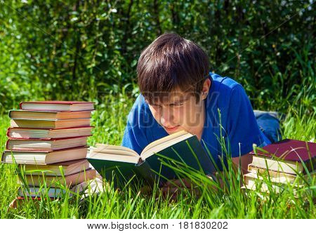Young Man read a Books on the Grass