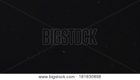 dust particles fly in the air over black background with light leak, 4k photo