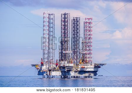 Labuan,Malaysia-Mac 25,2017:The layup drilling jackup rig at Labuan,Malaysia.Labuan is the most affected areas when the global oil price dropped & facing challenges when many companies left Labuan.
