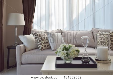 Living Room Design With Sturdy Tweed Sofa With Brown Patterned Pillows
