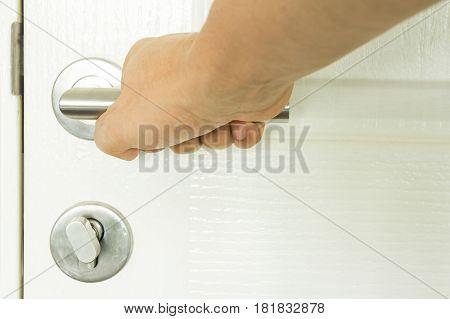 Close up hand to open close door knob